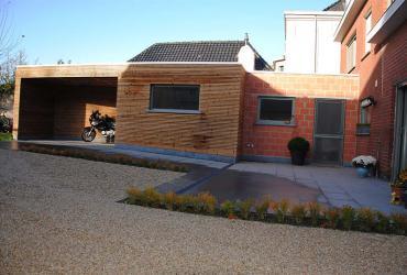 uitbreiding bestaande woning met aanleg terras en oprit